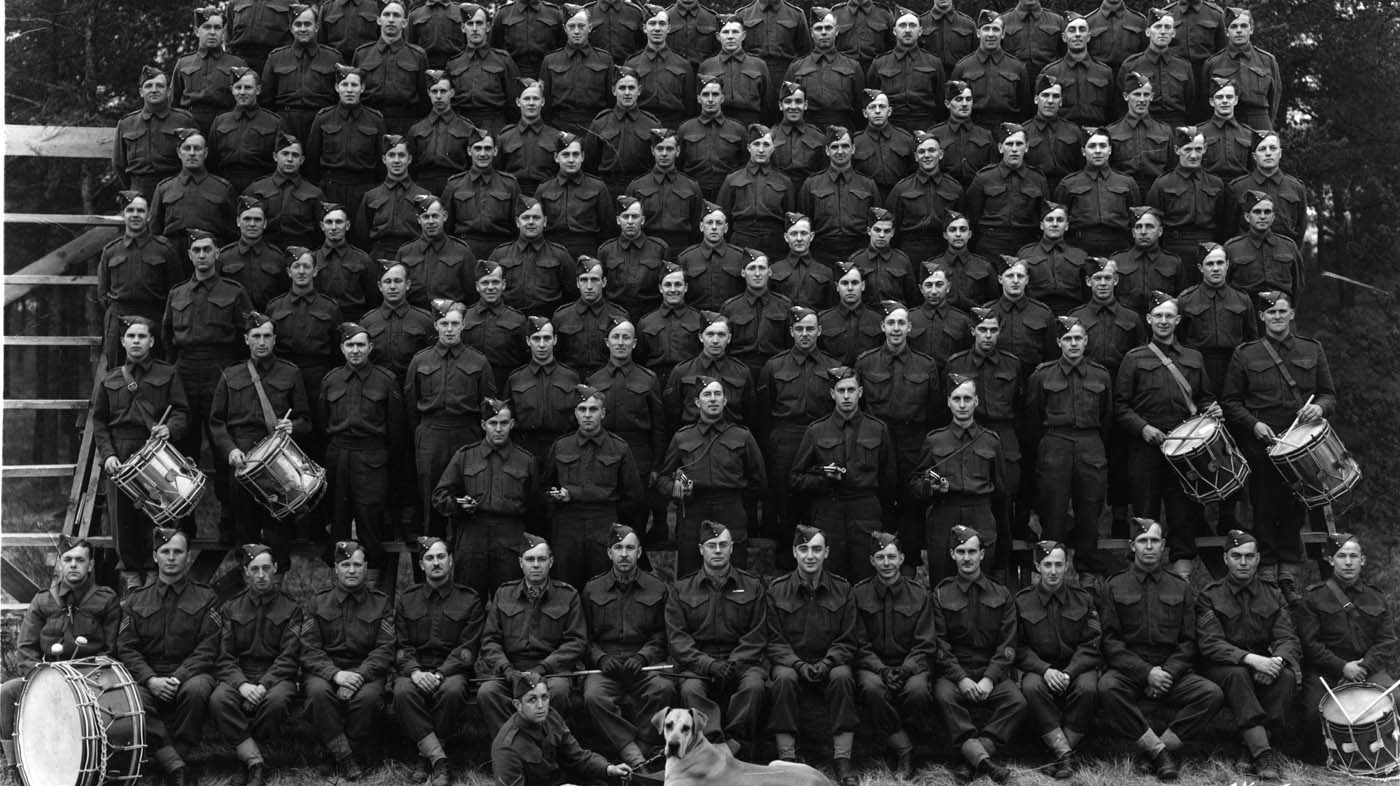 The Second World War had a profound effect on Canada. From every corner of the nation, men and women performed full-time duty in military service. During the war, 1,086,343 Canadians enlisted. The death toll by war's end reached 42,042. In Bruce County, recruitment for service differed from that of the First World War. Since the 160th Bruce Battalion had been disbanded in 1936 and reorganized as artillery, Bruce County men and women had the choice of joining one of four Bruce Field Batteries. Substantial numbers of Bruce County residents took the opportunity to enlist outside the County in the Army, Navy or Air Force, many joining area regiments such as the Perth Regiment and the Elgin Regiment.