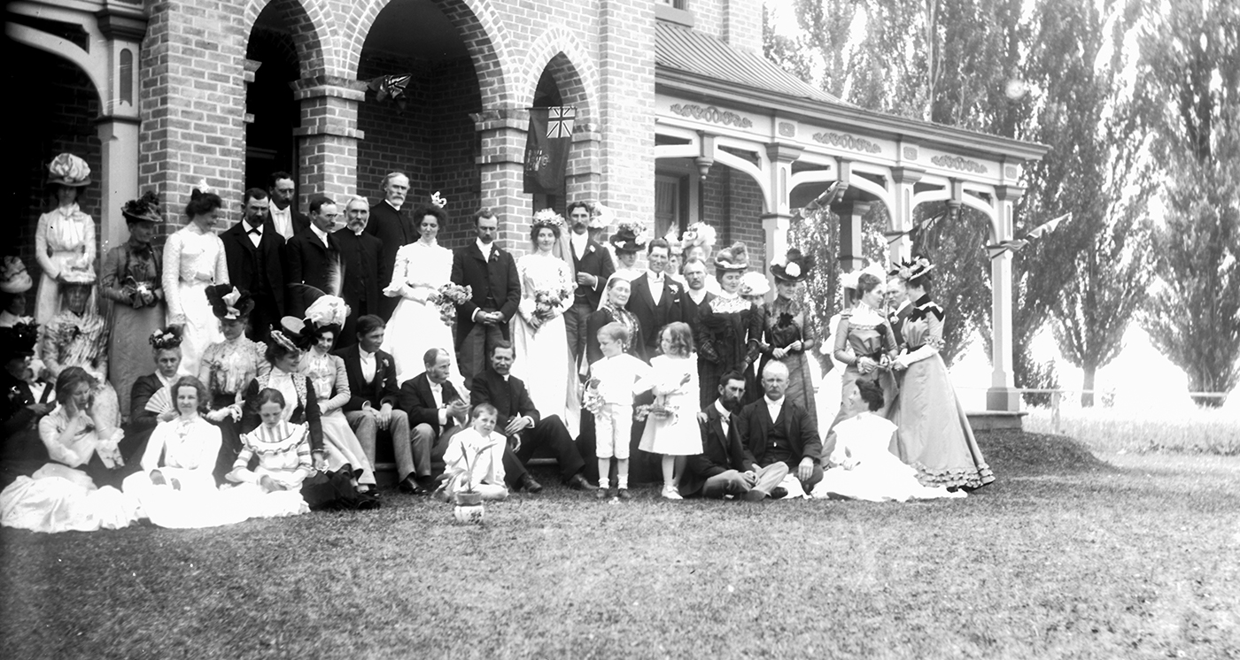 Photo of wedding party and guests at Hurdon-McKenzie House at lots 5 and 6, Concession 1 South of Durham Road, Kincardine Township