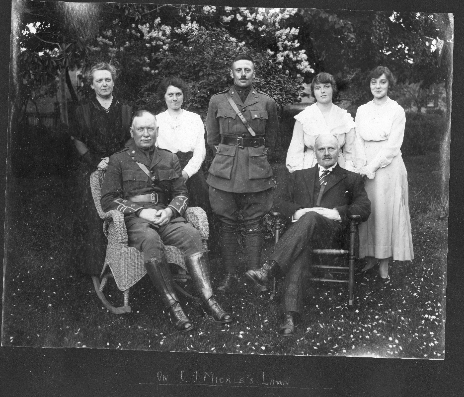 Group portrait on C.J. Mickle Lawn, Chesley, including Col. Weir, 1916